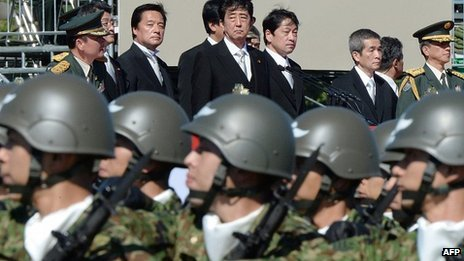 China is accusing Japan of using its national security as a pretext for military expansion photo