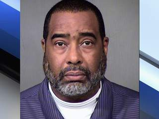 Earl Dennison Woods Jr. is accused of making a false bomb threat at the government building where he work photo
