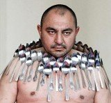 Etibar Elchiyev succeeded in sticking 53 metal spoons and breaking his own record