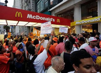 Fast-food restaurant workers are staging a 24-hour strike in protest against low wages