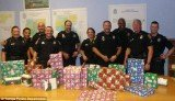 Florida police officers stepped in to donate presents to the family whose Christmas gifts and dog were stolen