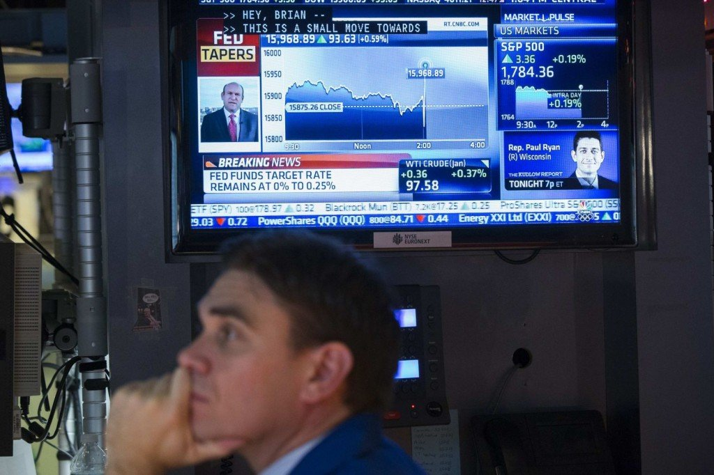 World stock markets rise after Fed stimulus trim announcement