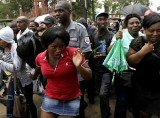 Hundreds of people pushed through police lines in a last-ditch bid to see Nelson Mandela lying in state
