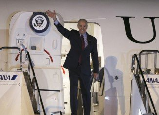 Joe Biden arrived in Tokyo late on Monday and will then head to Beijing and Seoul during his six-day visit