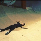 Justin Bieber wiping out on his skateboard as he attempts to perform a move