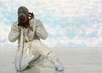 Kanye West halted his show in Phoenix to share his disappointment with fans after his album Yeezus failed to grab a nod in Grammys 2014 Album of the Year nominations