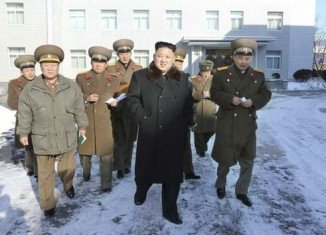 Kim Jong-un has been pictured by state media for the first time since the execution of his uncle Jang Sung-taek