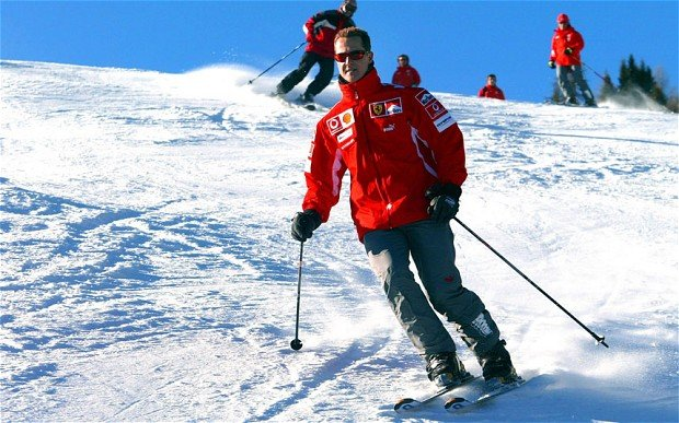 Michael Schumacher's condition has improved slightly after an operation to relieve pressure on his brain