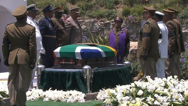 Nelson Mandelas body has been buried in a family plot in Qunu photo