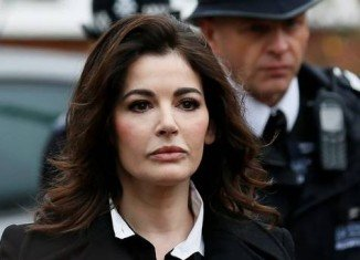 "Nigella Lawson has told a court her ex-husband Charles Saatchi threatened to ""destroy"" her"