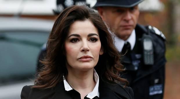 "Nigella Lawson has told a court her ex-husband Charles Saatchi threatened to ""destroy"" her"