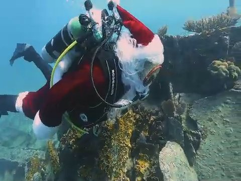 Santa took some time off from getting ready for his annual Christmas toy run to dive amid the marine life in Elbow Reef in the Florida Keys National Marine Sanctuary