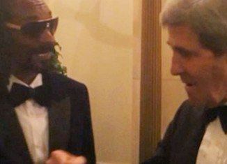 Snoop Dogg fist bumped with Secretary of State John Kerry during a party at the White House