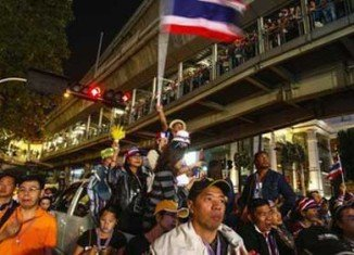 Thai anti-government protesters have surrounded the stadium where candidates were due to register to stand in February's elections