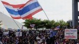 Thai police took down barriers and razor wire outside their building and it was announced that the protesters were welcome inside
