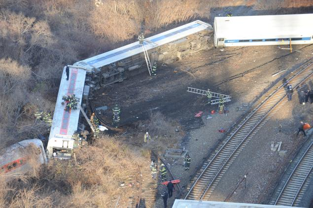 The Metro-North train's locomotive and carriages derailed as the train went into a bend in the railway line near Spuyten Duyvil station
