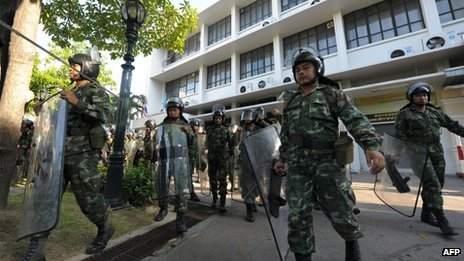 Troops have been deployed in Bangkok to support riot police shielding official buildings from anti-government protesters