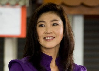 Yingluck Shinawatra has rejected protesters' demands that she resign before February's snap elections