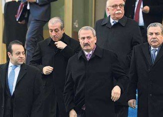 """Zafer Caglayan said he was stepping down """"so that all the light may be laid on this ignoble operation that targets our government"""""""