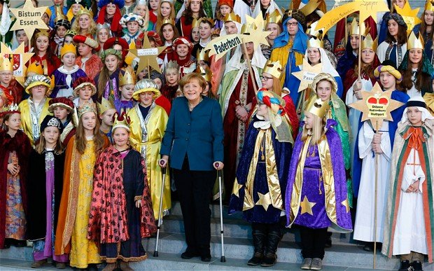 Angela Merkel has made her first public appearance since fracturing her pelvis in a skiing accident