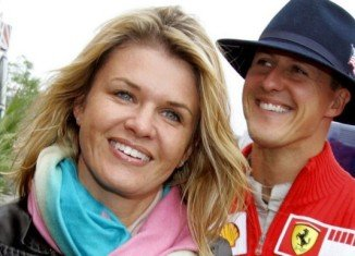 Corinna Schumacher has appealed for privacy and for reporters to leave the clinic where Michael Schumacher is being treated