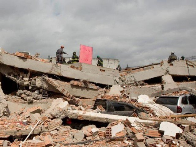 Dozens are feared trapped after the three-storey structure collapsed in the town of Canacona