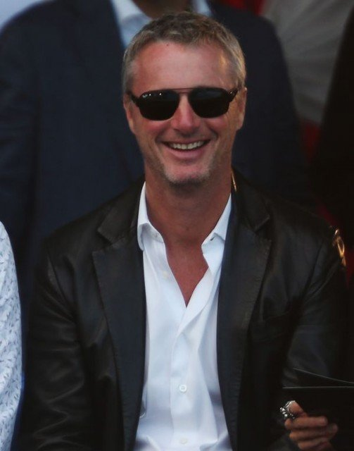 Eddie Irvine has been sentenced to six months in prison by an Italian court after a brawl with a man in a Milan nightclub