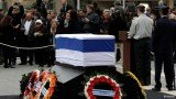 Israel's former PM Ariel Sharon was buried at his family ranch in the Negev desert