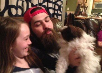 Jep Robertson and his daughter Lily Lulu with their new dog Gizmo