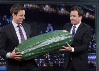 Jimmy Fallon officially handed-off the traditional Late Night giant plastic pickle to Seth Meyers