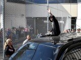Justin Bieber walked out of the Turner Guilford Knight Correctional Center surrounded by police and climbed atop his waiting SUV