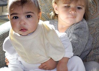 Kim Kardashian shared an adorable picture of her 7-month-old daughter North West with Kourtney's 18-month-old girl Penelope