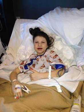 Mia Robertson is recovering from a major bone graft procedure for her cleft photo