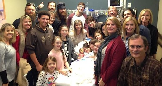 Mia Robertson with a large swath of her extended family at her bedside photo
