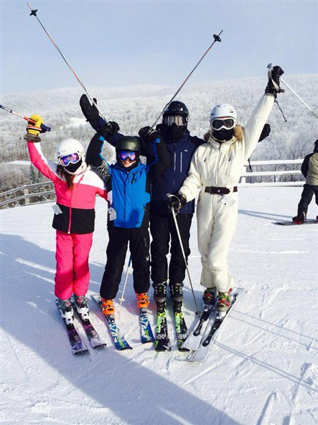 Michael Douglas and Catherine Zeta Jones spent the holidays skiing with their two children on New Years Day photo