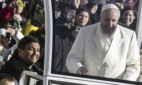 Pope Francis invited Father Fabian Baez to join him on his Popemobile at the Vatican photo