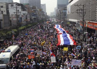 Thai protesters have surrounded polling stations, blocking early voting ahead of next week's general election
