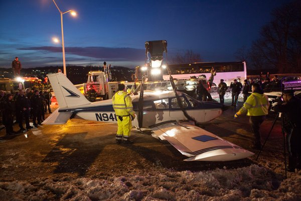 The small plane touched down on the interstate highway on Saturday afternoon after maintenance workers repairing potholes stopped traffic to leave the road clear