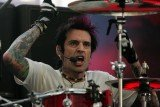 Tommy Lee has won a legal battle against engineer Scott King who alleged the rocker stole his idea for a drum kit rollercoaster
