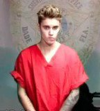 A Mimi Beach officer attempted to photograph Justin Bieber while he was in a temporary holding cell