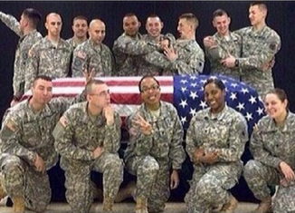 A member of the Wisconsin National Guard was suspended from honor guard duties after she apparently posted this photo to social media