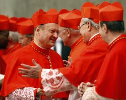 Cardinals wear red robes, along with scarlet zucchetto and biretta
