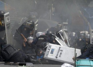 Clashes erupted in central Bangkok on Tuesday with several protesters and police officers injured
