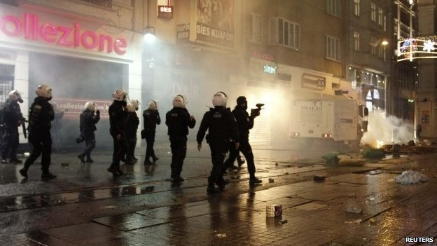 Demonstrators threw fireworks and stones at police cordoning off Taksim Square