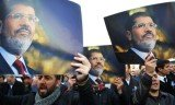 Egyptian prosecutors have accused ousted President Mohammed Morsi of leaking state secrets to Iran's Revolutionary Guards