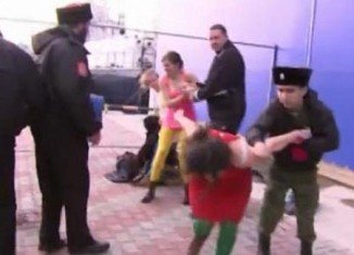 Five members of punk group Pussy Riot and a cameraman were attacked by Cossack security patrols in Sochi