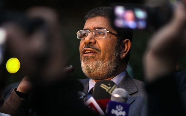 Mohamed Morsi's lawyers have walked out of his trial on charges of espionage and conspiring to commit acts of terror