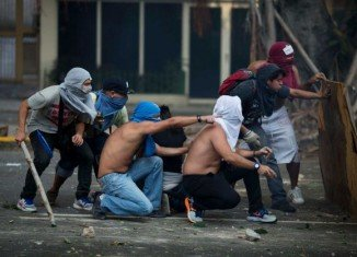 Police and opposition demonstrators have clashed in Venezuela at the end of a march that gathered tens of thousands of people in Caracas