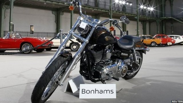 Pope Francis' Harley-Davidson has been sold for 210,000 euros at Bonhams auction in Paris