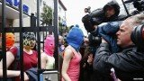 Pussy Riot members and two other women emerged from the police station in Sochi wearing their trademark ski masks after their brief detention